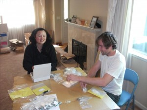 Eri and Will packing OpenPCR thermal cycler bags